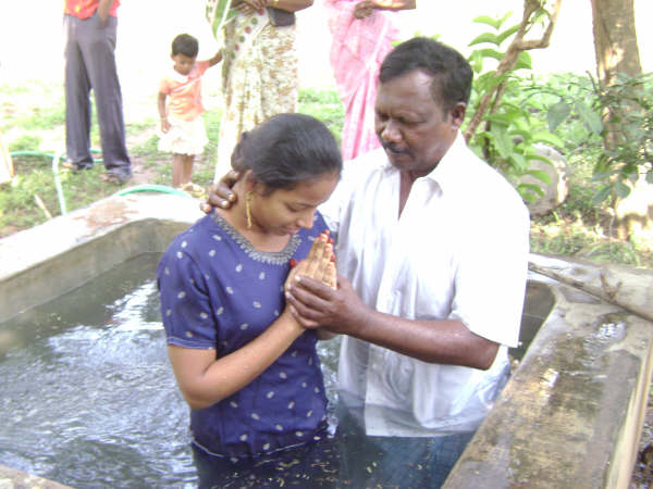 A young lady being baptised